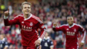 Darren Mackie netted early on for Aberdeen, who held on for a narrow win over the Dark Blues.