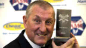 Inverness CT manager Terry Butcher is presented with his award after being inducted into the Scottish Football Hall of F