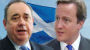 Alex Salmond has challenged David Cameron to meet him in Abu Dhabi.