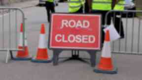 General view of a road closed sign with barriers. Quality image.