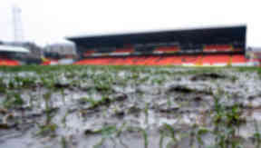 Water gathers on the Tannadice pitch but the match goes ahead despite the constant bad weather in 2009.
