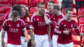 Gavin Rae (centre) celebrates with his team mate's after putting Aberdeen ahead.