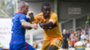 Motherwell's Zaine Francis-Angol (right) holds off a challenge from Inverness CT's David Raven.
