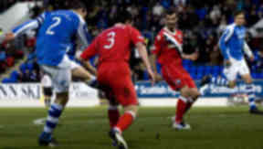 Dave Mackay (left) slots his effort home to break the deadlock for St Johnstone