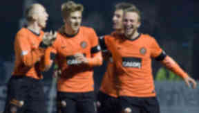 Dundee Utd ace Stuart Armstrong (centre) celebrates his goal with team mates.