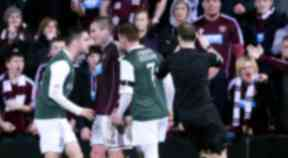 Trouble flares after Hearts' Ryan Stevenson (2nd left) put in a nasty tackle on James McPake (right)