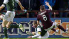 Hibernian captain James McPake takes down Scott Robinson (8) in the box but nothing is given.