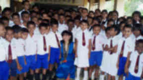 Healing power: Dr. Tanya Ekanayaka with children from one of Sri Lanka's  schools in the country's southern district of Hambantota.
