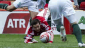 Aberdeen's Peter Pawlett (bottom) goes down in the penalty box under a challenge from Tom Taiwo and is later booked for diving.