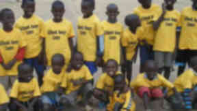 Football links: Some of the children in Nairobi with the kit from Giffnock Soccer Centre.