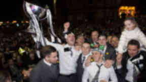 St Mirren celebrate their Scottish Communities League Cup victory with an open top bus parade through Paisley. Marc McAusland holds the trophy as the players celebrate in front of the supporters