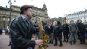 Protesters gather in George Square to mark Margaret Thatcher's death