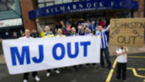 Young Kilmarnock supporter Sean Dean (right) backs now former manager Kenny Shiels. Rugby Park protest on June 11 2013
