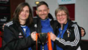 Glasgow City Laura Montgomery and Carol Anne Stewart, along with Head Coach Eddie Wolecki Black with the League Cup