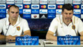 FC Shakhter Karagandy manager Viktor Kumykov and captain Andrei Finonchenko (left) speak with the press ahead of the UEFA Champions League play-off clash with Celtic.