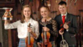 Glenfiddich Fiddling Championship 2013. From left: Winner Maura Shawn Scanlin, Maggie Adamson, Graham MacKenzie