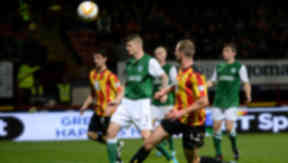 Partick's Christie Elliott (2nd from right) looks on as his effort is saved by Hibernian keeper Ben Williams