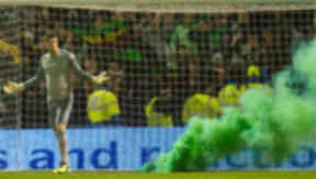 Fraser Forster stands next to a smoke bomb during Celtic's win at Motherwell.