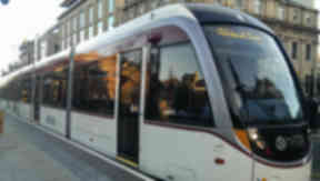 Edinburgh tram in St Andrew Square with new branding.