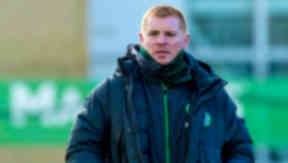 Manager Neil Lennon looks on as his squad are put through their paces.