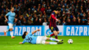 Martin Demichelis is sent off for this challenge on Lionel Messi