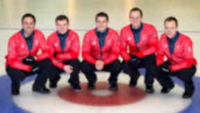 Cold comfort: David Murdoch and his all-Scottish team won silver to add to the women's team's bronze.