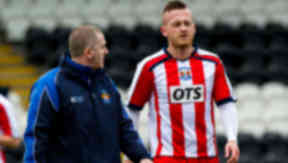 Kilmarnock's Sammy Clingan (right) leaves the pitch after picking up an injury