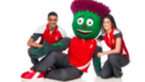 Glasgow 2014 uniform launch featuring members of staff; Arjan Singh, Taylor Sexton and Clyde the Mascot