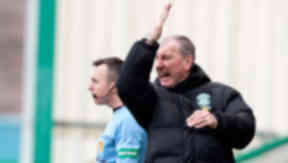 Hibernian manager Terry Butcher barks orders from the touchline.