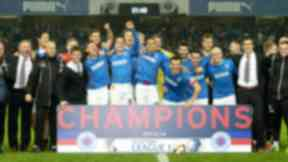 The Rangers squad celebrate after winning the Scottish League One championship.