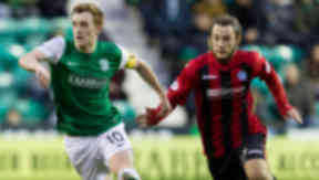 Hibernian's Liam Craig breaks free of Stevie May (right)