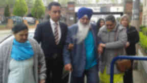 Surjit Singh Chhokar family of murdered waiter with solicitor Amer Anwar on way to meeting with Lord Advocate. Pic from Broadcast.