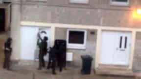 Still from a video of a police raid in Cambuslang on June 20, 2014, after two people were attacked with a knife.