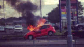 Car on fire on back of tow truck outside Forge Shopping Centre in Glasgow. Twitter image from Danielle Middleton. August 15 2014