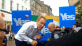Jim Murphy MP dodges an egg while campaigning for a No vote during his tour before the independence referendum