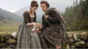 Outlander: Sam Heughan as Jamie Fraser and Caitriona Balfe, who plays Claire Fraser.