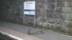 Felled: Power line lying on platform.