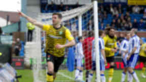 Celtic's Charlie Mulgrew celebrates heading Celtic in front
