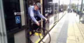 Iain Maxwell of Spokes, takes bike on an Edinburgh Tram