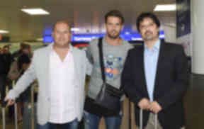 Celtic target Logan Bailly (centre) arrives at Glasgow Airport ahead of holding talks with the club