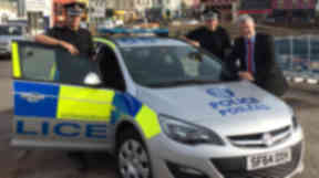 Gaelic-branded Police Scotland car with Chief Inspector Gordon Campbell (Gaelic speaker), Supt Gordon Macleod and Ian Ross (SPA Board Member). Uploaded with permission from Police Scotland on October 15 2015.