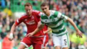 Celtic's Jozo Simunovic (right) battles with Adam Rooney