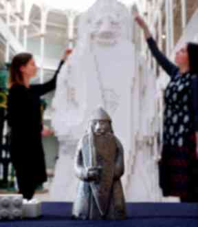Finishing touches: Museum staff Lyndsay McGill and Alice Wyllie  complete the sculpture.