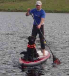 Dean with his dog Stumpy at the helm.