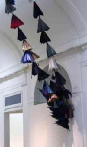 The flock of umbrellas try to break through the celing