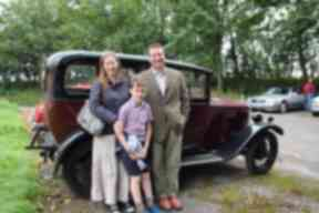 Robin Wills and his family with the Humber they restored.