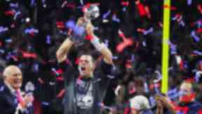Tom Brady wore a champions t-shirt as he collected the Super Bowl prize.