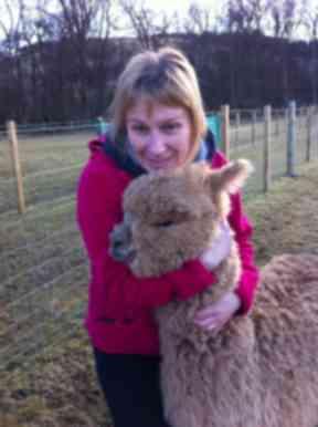 A happy visitor to the alpaca farm.