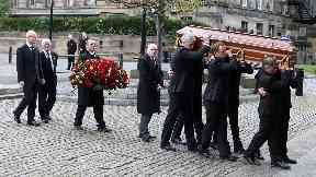 Funeral: Sir Arnold's coffin carried into Glasgow Cathedral.