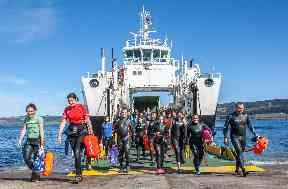 Swimmers disembarking from the ferry ready to tackle the Sound of Mull.